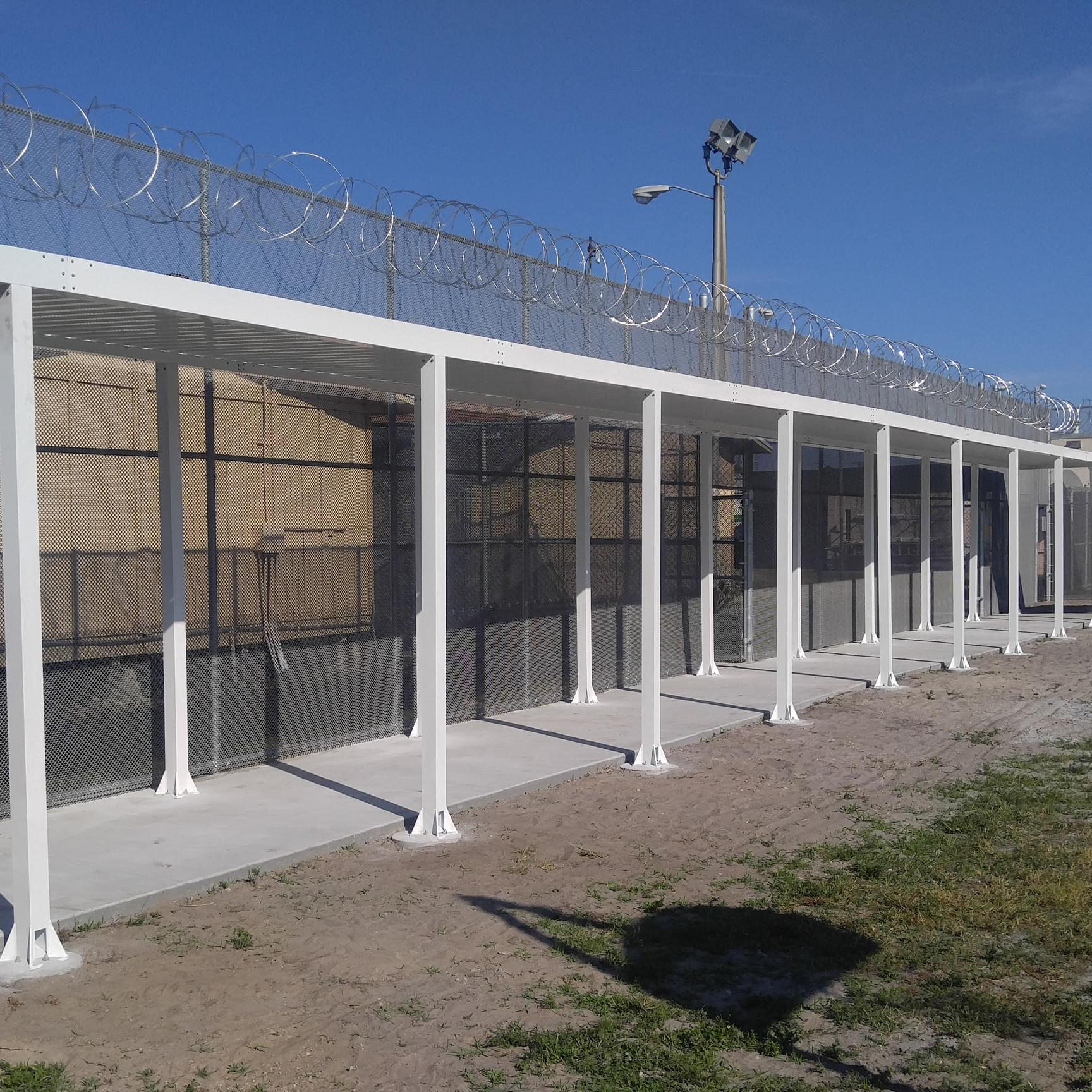 Sidewalk canopy for correctional facility & 4 Types of Industrial Aluminum Canopy Designs - Upside Innovations