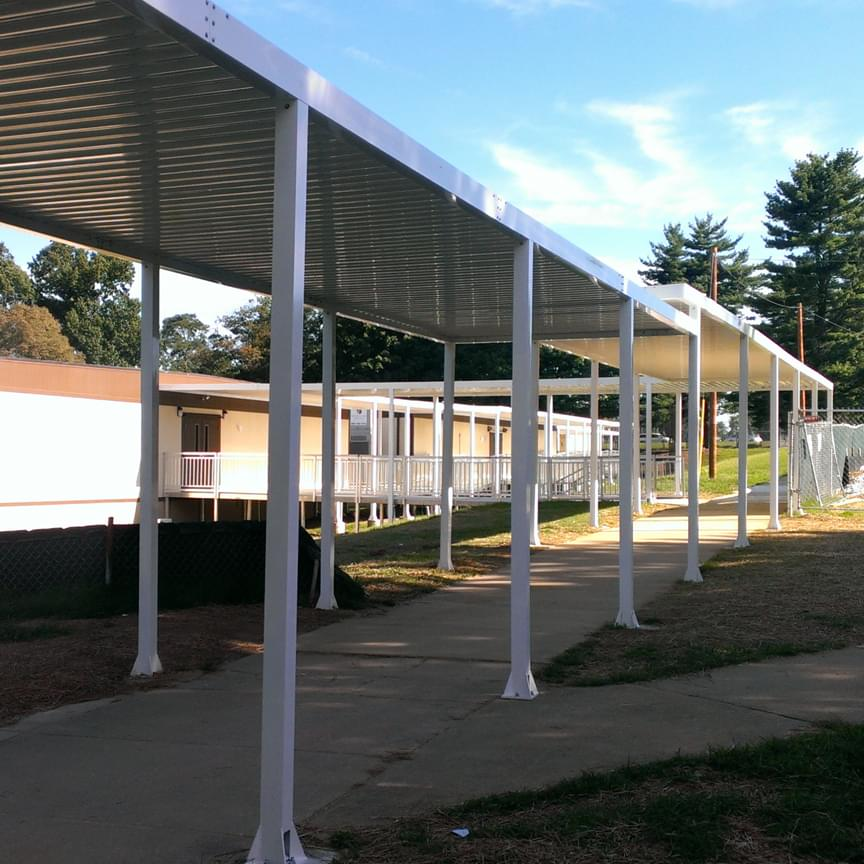 aluminum walkway canopy for modular school building & 4 Types of Industrial Aluminum Canopy Designs - Upside Innovations