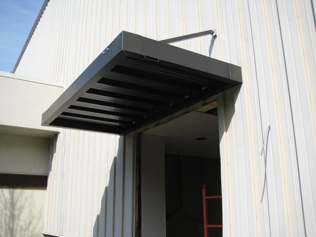 Overhead canopy for loading dock