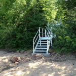 aluminum hillside stairs that lead down to the beach