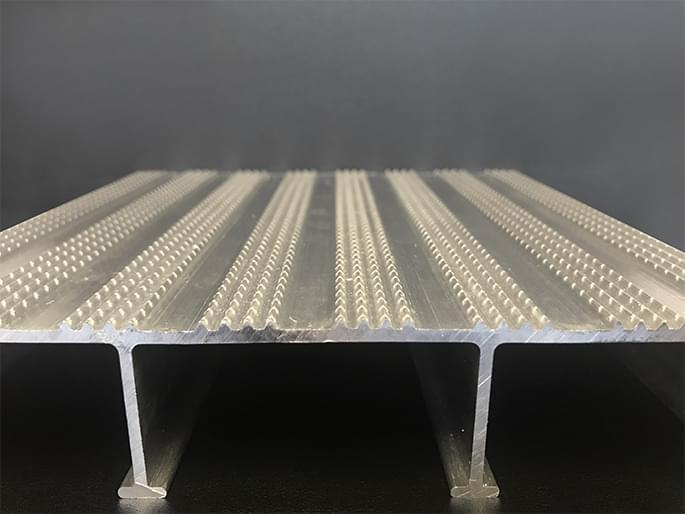 Cross section of extruded aluminum decking for wheelchair ramp