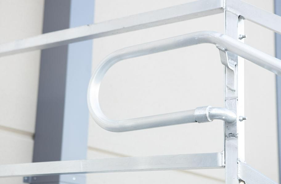 Up-close handrail and guardrail connection of warehouse loading dock steps