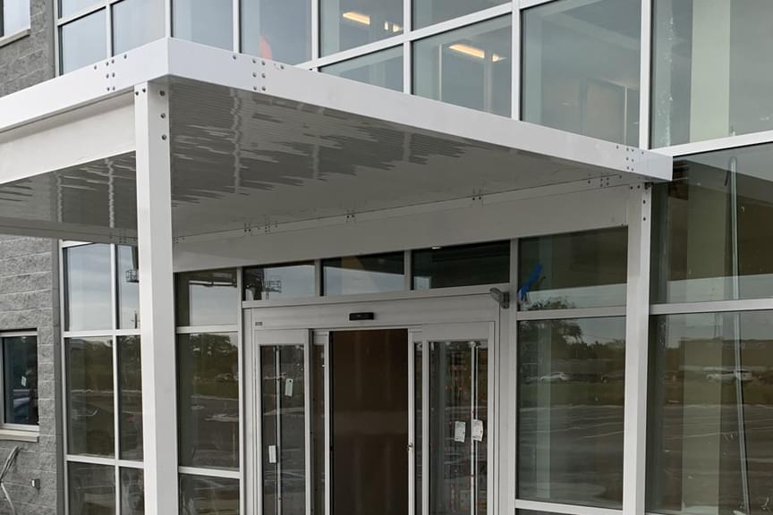 White aluminum canopy over office doorway
