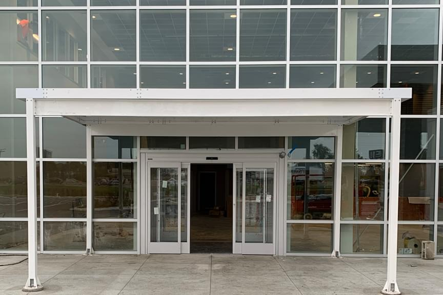 20-foot by 12-foot white aluminum canopy for office entrance