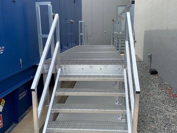 Long generator walkway with aluminum stairs on either end