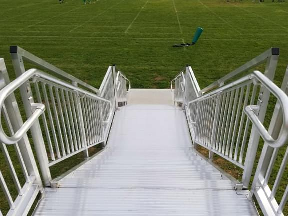 Aluminum hillside steps that go down to football field