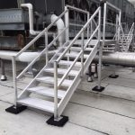 Aluminum crossover bridge and stairs on top of roof