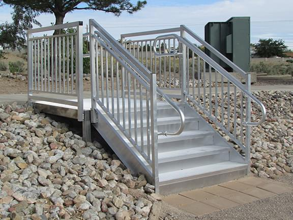 Aluminum ADA-compliant hillside step to parking lot